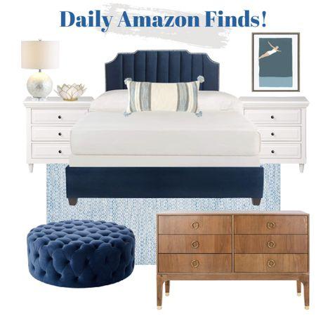 Shop this blue bedroom - all decor available from Amazon!    http://liketk.it/3k5ak #liketkit @liketoknow.it #LTKhome #LTKsalealert #LTKunder100 blue bed frame, blue rug, blue ottoman, coastal art, white nightstand, throw pillow, wood dresser, capos lamp