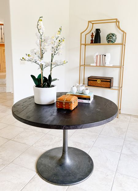 This tulip table and faux orchid make a statement in this foyer.  Foyer table, tulip table, round table, pedestal table, entryway decor, home decor, faux flowers, faux plant  #LTKhome
