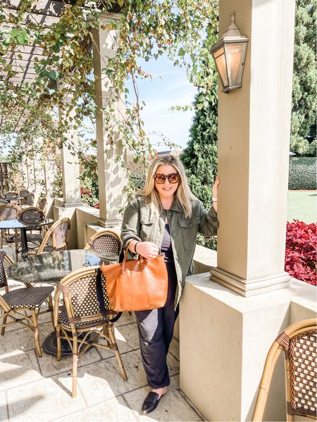 Fall aniversary getaway to chateau elan! This army shacket is on sale and is a fall staple and can be dressed up or down (I sized down one). My favorite leather day bag has been my purse for over a year, I have these madewell leather mules in multiple colors (on sale right now!), and my huge oversized sunglasses are $14 on Amazon! My black jumpsuit is also Kim major sale! Favorite nude lipstick in shade STAYCATION #ltkunder100 #ltkunder50 amazon finds amazon find amazon fashion sunnies leather tote bag purse loafers mules prime jumpsuit fall outfit weekend outfit vacation   #LTKitbag #LTKSeasonal #LTKshoecrush