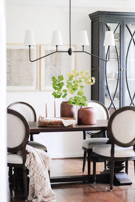 Transitional Dining Room  What a difference paint makes!  My table + chairs are restoration hardware but I cannot link them so I'm sharing similar items!   Dining room   modern transitional home   dining room table   trestle table   salvaged wood table   upholstered dining chairs   rejuvenation lighting   rejuvenation chandelier   dining room chandelier  #LTKhome #LTKsalealert #LTKfamily