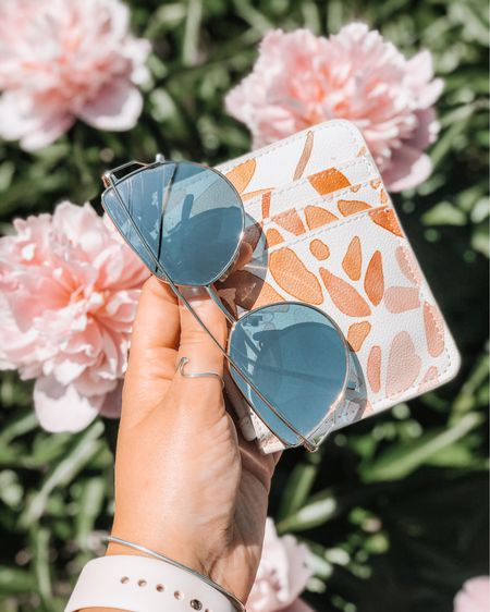 I'm all for leaving my purse at home this summer. Check out this floral pattern summer wristlet from love & lore (Indigo's brand of purses and bags!).  This little wristlet pairs perfectly with these pink polarized sunglasses from amazon (a steal at under $20). You won't catch me on a patio without these two accessories!   http://liketk.it/2SJjQ #liketkit @liketoknow.it #LTKunder100 #LTKunder50 #LTKstyletip #wristlet #loveandlore #ltkday #indigo #polarizedsunglasses #amazonfinds #summerstyle