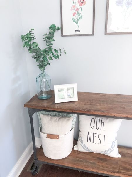 I'm so obsessed with my new glass vases from Hearth & Hand with Magnolia and these cute fabric storage baskets from Target that I had to buy them for multiple areas of my home! This entry table is in the early stages of decorating but loving it already 😍  #StayHomeWithLTK #LTKfamily #LTKhome