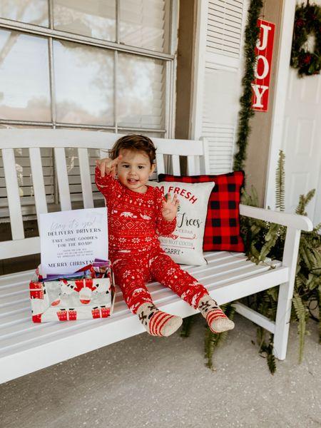 Christmas pajamas on the front porch. http://liketk.it/32VfL #liketkit @liketoknow.it #LTKfamily #LTKkids #LTKhome #bench #porch #catnjack #christmaspajamas #throwpillow #christmas #christmasdecor #target