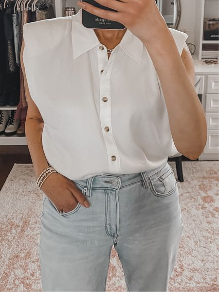 In love with this sleeveless button down shoulder pad top from Nordstrom. It's really really soft and smooth, doesn't wrinkle, and it's classic and classy!!  #LTKunder100 #LTKunder50 #LTKstyletip