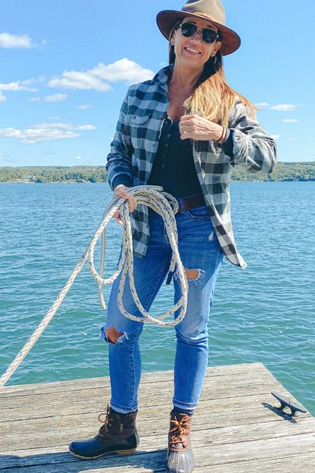 My boyfriend flannel is perfect for a fall boat ride. Layered over a thin green fitted Henley, distressed jeans, and my LLBean boots have me ready for the random temperatures of fall. I love to wear my wool fedora and Ray-Ban Aviators every chance I get!  #LTKunder50 #LTKstyletip