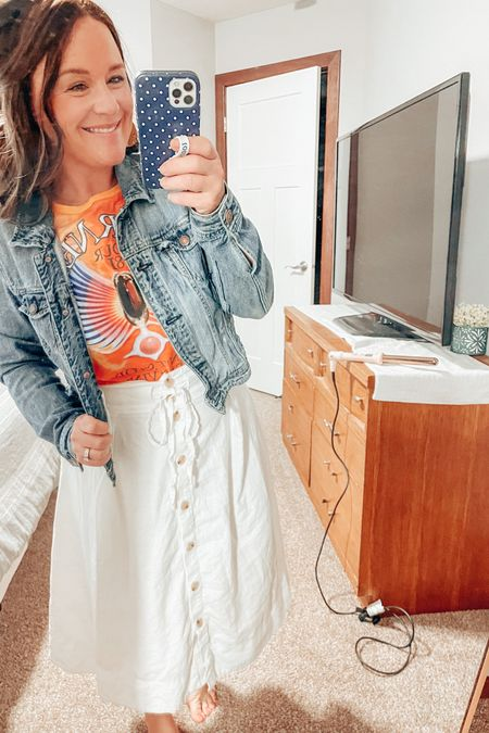 Who else loves bright colors on Mondays? I paired my bright Journey graphic tee with my favorite white skirt with my jean jacket! It's the perfect mix of weekend fun and Monday scaries 🤪  Also, I love mixing up my curls by using my L'Ange wand over my iron. You get such fun and thick waves! http://liketk.it/3eYKJ #LTKworkwear #LTKunder50 #LTKstyletip #liketkit @liketoknow.it