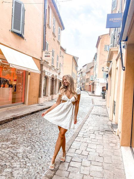 This dress is SO CUTE and only $18! Some pastel yellow shoes to go with it 💛 #littlewhitedress #sttropez  #LTKunder50 #LTKsalealert #LTKtravel