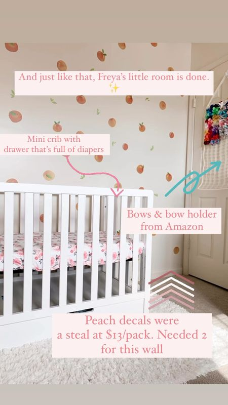 The sweetest small space baby girl nursery - mini crib, peach 🍑 themed & all the bows   #LTKunder50 #LTKhome #LTKbaby