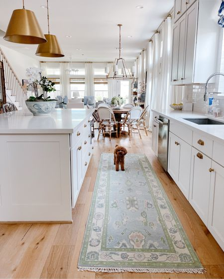 Our light & airy kitchen with a new oushak runner & gold pendant lights!   #LTKhome