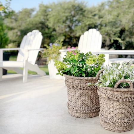 I am obsessed with using baskets as planters! I haven't found these exact baskets, but I have found a few others that are similar. Perfect for patio and porch. You may need to line the inside with plastic to protect your basket when using as a planter.   #LTKhome #LTKstyletip