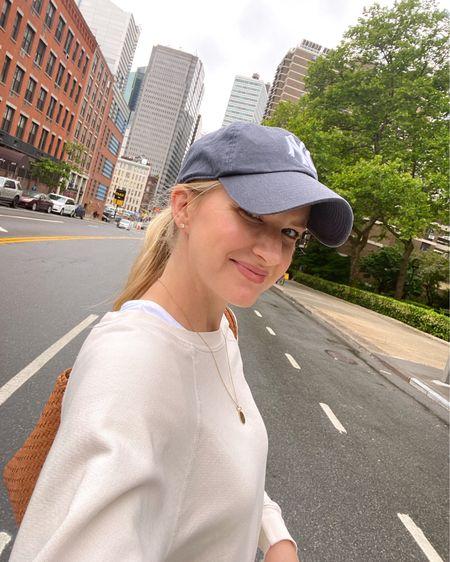 Bone colored sweatshirt, NY Hat and vintage denim http://liketk.it/3hCUk @liketoknow.it #liketkit