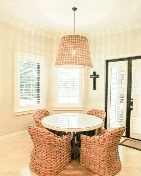 Coastal kitchen dining feel is always the best. This is one of my favorite blog entries at bossinfashion.com. I love the straw chairs and lamp as well as the glass table. It's a simple room with great impact.   Shop this amazing space with links and some dupes. The chairs are from Serena & Lily as well as the table. The lamp is from Urban loft (couldn't link this). But I am sharing some duplicates on this and other pieces of this space. Happy shopping! You can instantly shop all of my looks by following me on the LIKEtoKNOW.it shopping app #StayHomeWithLTK #LTKhome @liketoknow.it.home http://liketk.it/34FFX #liketkit @liketoknow.it