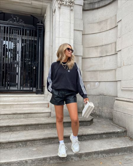 Adidas oversized sweatshirt with black faux leather shorts and balenciaga triple s trainers. - autumn style. - autumn ootd - fall fashion outfit - transitional style   #LTKunder100 #LTKSeasonal #LTKeurope