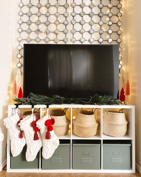 Christmas TV Console ✨ This twinkle light curtain is my favorite purchase of the season. http://liketk.it/32osV   Shop your screenshot of this pic with the LIKEtoKNOW.it shopping app @liketoknow.it.home @liketoknow.it #liketkit #LTKgiftspo #StayHomeWithLTK #LTKhome