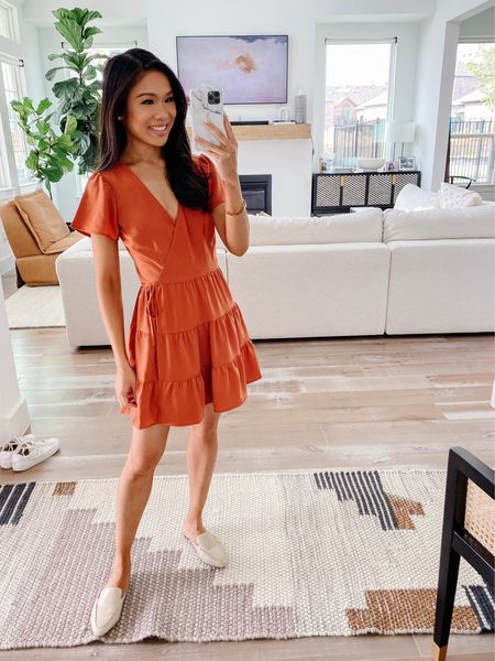 Fall dress on sale! Love this tiered wrap dress in burnt orange for fall outfits. Get 25% off with the LTK sale! Wearing size XXS, fits perfectly and on petites. I got regular sizing though.   #LTKsalealert #LTKSale #LTKunder50