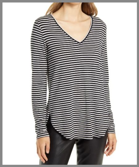 V-neck long sleeved cotton top with a loose or a blousy midsection length is long so it would be a great for a taller person. Great for layering in the fall in cooler weather.