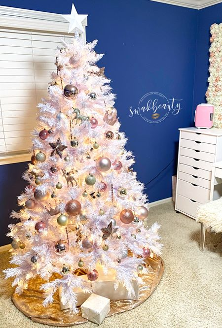 I'm absolutely thrilled with how my Beauty Room tree came out! The soft white prelit tree, flecked in silver glitter, illuminates each bulb and ornament so beautifully. ✨ The blush, champagne and glitter theme of ornaments really give it a magical touch, don't you think? 🤩  #LTKunder100 #LTKhome #StayHomeWithLTK