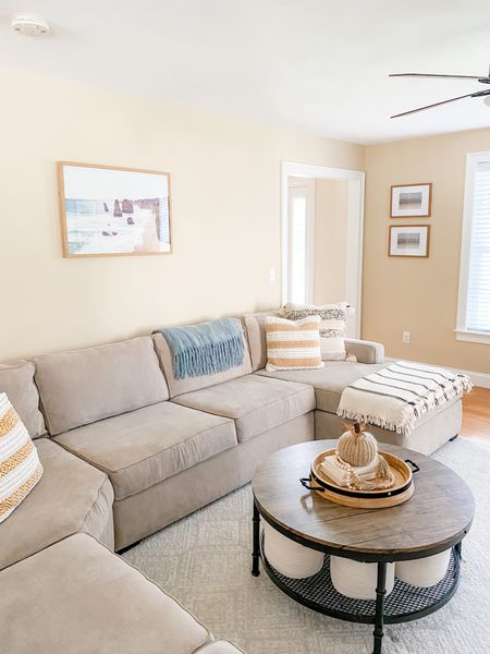 A few updates to the living room decor ✨ Available items are linked along with some similar 🌿   Living room decor   neutral decor   coffee table   white couch   sectional   coastal decor   family room   #LTKhome #LTKSeasonal #LTKsalealert