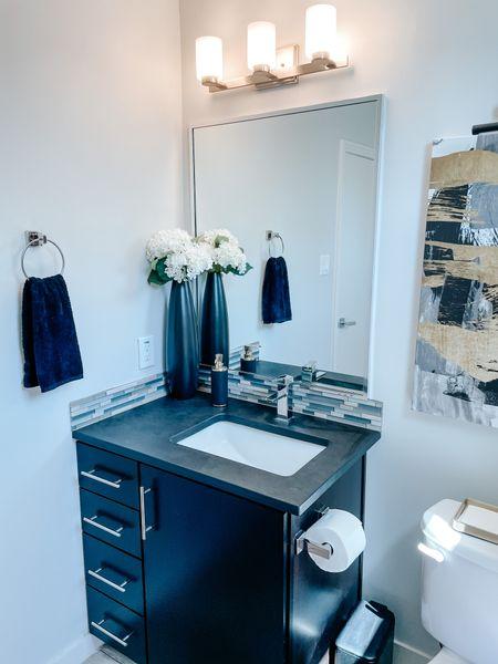 Powder bathroom Devore. Modern bathroom black vase gold accents. Abstract canvas. Gold paper towel tray.  #LTKhome #LTKstyletip