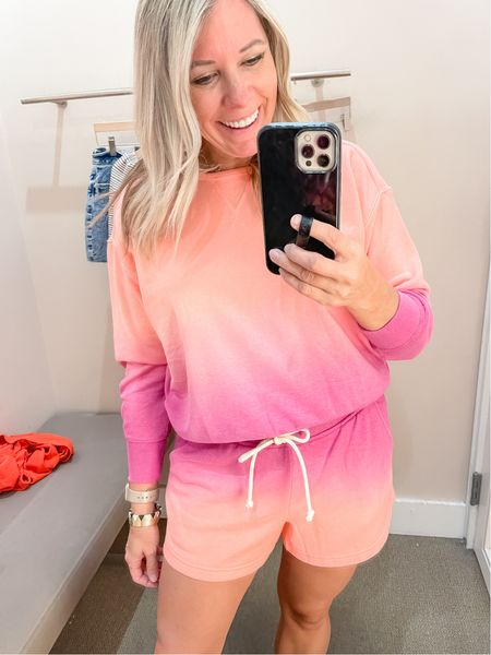 Love this orange and pink ombre sweatshirt and shorts matching set. Wearing a size small in both which run true to size. Both are 50% off right now. Loft sale matching set loungewear  #LTKSeasonal #LTKunder50 #LTKsalealert