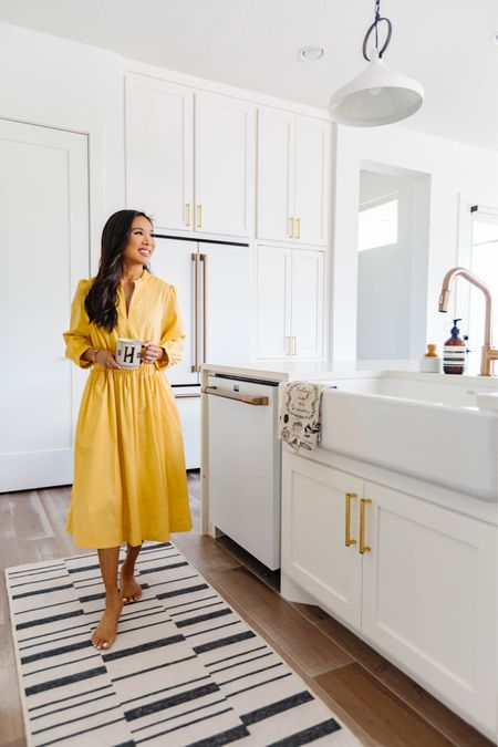 White kitchen decor with a washable runner rug, brass cabinet hardware, brass kitchen faucet and white appliances that are fingerprint resistant. We love our refrigerator so much we had to get the matching dishwasher!   #LTKstyletip #LTKhome