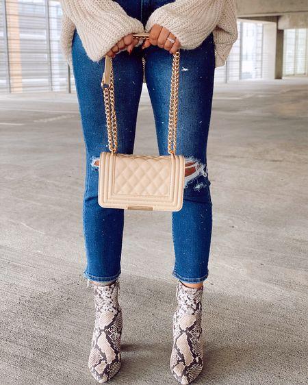 Snake booties TTS Ripped jeans Cross body bag http://liketk.it/2KDmR #liketkit @liketoknow.it #LTKunder50 #LTKstyletip #LTKsalealert