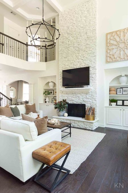 Fall living room decor-  neutrals and naturals! The pillows are perfect to mix and match for any earthy look for any season! Home decor great room fall decor great room throw pillows white sofas couch fireplace decor rug  #LTKSeasonal #LTKstyletip #LTKunder100