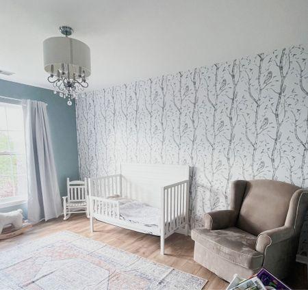 Rug, Nursery, lights, curtains, swivel chair, crib, wallpaper   #LTKhome #LTKfamily #LTKbaby