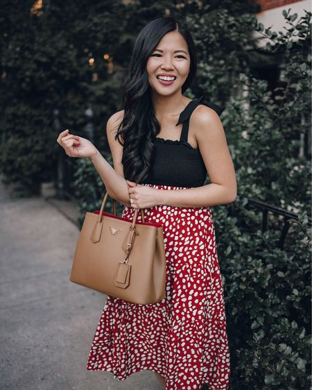 Casual spring outfit, Amazon finds: black smocked tie strap tank (S), red leopard print midi skirt (S), Prada Cuir Saffiano tote bag (linked a similar style that's way more affordable), white leather sneakers from Keds (6.5 TTS). @liketoknow.it http://liketk.it/37UFe #liketkit #LTKunder50 #LTKstyletip