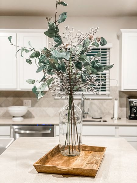 Obsessed with this floral arrangement for our kitchen island. Paired with a wooden serving tray of course! Glass vase. Floral arrangement. Kitchen decor. Island decor.   #LTKSeasonal #LTKhome #LTKunder50