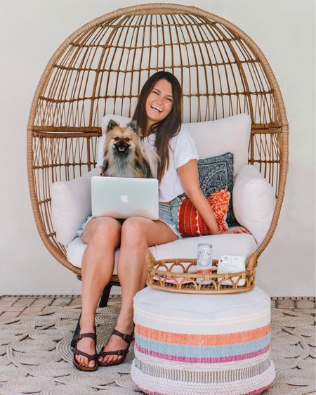 What my blogging situation truly usually looks like 😂 @nashkeepsup in my lap, perched in my favorite #eggchair, with my phone and a drink (usually a coffee, water, or @whiteclaw) nearby 🙌🏼. I'm answering the blogging/Instagram questions that you submitted over on Keeping Up with Kahla today 👩🏻💻. Find out what my least favorite part about blogging is, which presets I use, and more through the link in my bio. 😘 http://liketk.it/2Ah1y #liketkit @liketoknow.it #LTKunder50 #LTKunder100 #LTKshoecrush #LTKstyletip #LTKsalealert #LTKhome #target #opalhouse #birkenstocks #patio #patiodecor #pouf #outdoordecor