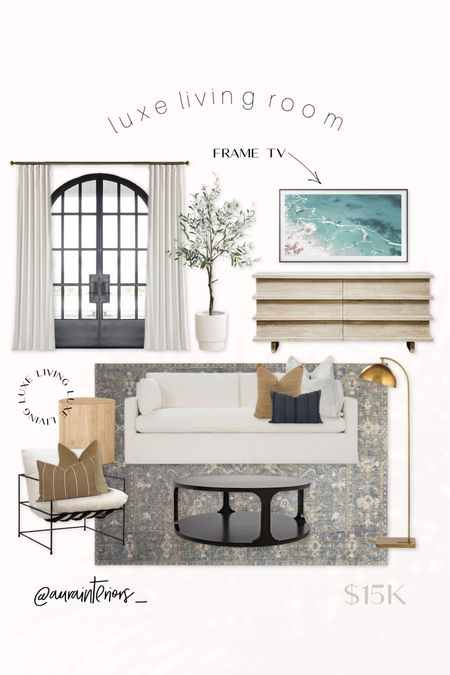 Luxe living room 🖤 I'm living for these natural woods, black tones + muted colors! Everything linked below ✨  Shop my daily looks by following me on LIKEtoKNOW.it!! 🛒 http://liketk.it/3bTev #liketkit @liketoknow.it @liketoknow.it.home #LTKhome   luxe living room, luxe family room, luxe living room design, luxe family room design, California living room, California family room, living room design, family room design, luxurious living room, luxurious family room, living room mood board, family room mood board, Chris loves Julia rug, ivory window treatment, ivory curtains, ivory drapes, neutral living room, neutral family room, upscale living room, upscale family room, frame tv art, frame tv, frame tv digital art, beach art frame tv, Corliss dresser, dresser as media center, whitewash media center, light wood media center, light wash dresser, whitewash dresser, olive tree white pot, olive tree white planter, large olive tree, large faux olive tree, artificial olive tree, faux olive tree, cream sofa, ivory sofa, slipcover sofa, luxe sofa, Myla slipcover sofa, myla sofa, Grady coffee table, black round coffee table, black coffee table, Grady espresso coffee table, Yates chair, Yates accent chair, uli dresser, rosemarie collection no. 3, Rosemarie rug, Samsung frame, Samsung frame tv, pillow combinations, pillow combos, living room pillows, family room pillows, neutral throw pillows, neutral throw pillow combo, cream throw pillow, rust throw pillow, black lumbar pillow, black throw pillow, light wood side table, light wood end table, white chair black metal, white chair black legs, brass floor lamp, Regina Andrew Otto floor lamp, Otto floor lamp, gold floor lamp, expensive living room, expensive family room, professionally designed living room, professionally designed family room, chic living room design, chic family room design, interior designer living room, interior designer family room, white sofa, white slipcover sofa, gray rug living room, grey rug living room, gray