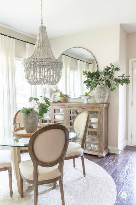Foraged tree branches from my yard are the perfect vase filler for fall in my breakfast nook. Home decor dining room decor beaded chandelier round mirror ritva curtains stone vase dining chair jute rug  #LTKSeasonal #LTKhome #LTKstyletip