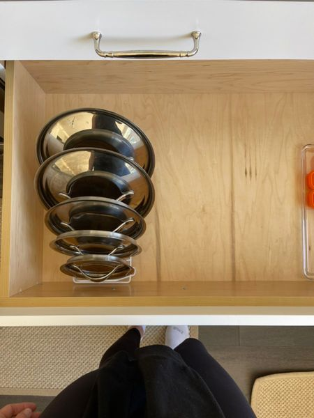 Easy compact way to store pan lids. #storage #organization #potsandpans #kitchenstorage #kitchenorganization  #LTKhome