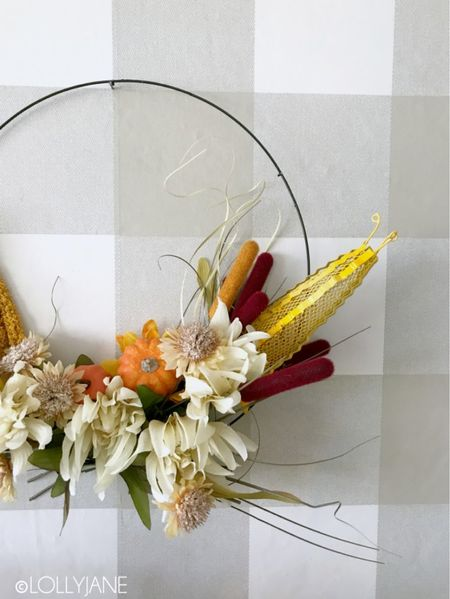 Make an easy wreath this fall with inexpensive items from the dollar spot! 🍁 See how we put ours together: https://lollyjane.com/dollar-store-fall-hoop-wreath     #LTKhome #LTKunder50 #LTKSeasonal