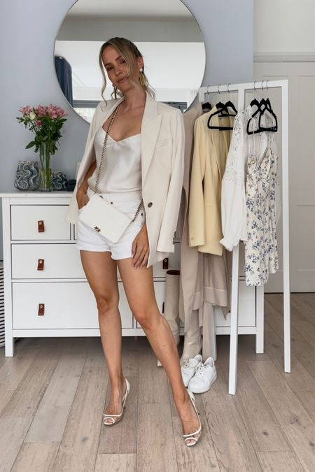 I'm 5'5 and I'm wearing waist 26 in the white jeans shorts. They are a bit large on me, I'm normally a w25. So pick your normal size   The cream blazer is a size U.K. 6. Size up for a more oversized look.  My pumps are unfortunately old, but I have linked some similar ones ❤️  #LTKeurope #LTKstyletip #LTKSeasonal