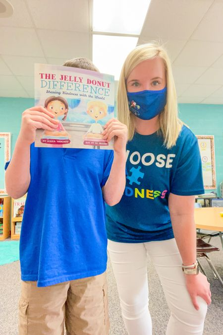 CHOOSE KINDNESS 💙 Today we talked all about kindness when we read A Jelly Donut Difference! It is such a cute book and all of my students loved it… especially the one who volunteered to take this picture with me 🤣🥰 My adorable 🧩 tshirt is from Walmart and I highly highly recommend it! 💓 Shop both my shirt & this book for your classroom library here in the @liketoknow.it app 👉🏻 http://liketk.it/3e9FC  • • •  #liketkit #LTKkids #LTKunder50 #LTKworkwear #choosekindness #autismawareness #autism #teachersofinstagram #teacherlife #lovemyjob #teacherstyle #teacherootd #teacherootdthursday