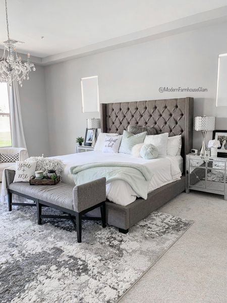 Master bedroom furniture, neutral area rug, distressed rug, gray rug, tufted headboard, king-size bed, mirrored nightstand, nightstand lamp, crystal chandelier, swivel chair, bedroom bench, modern farmhouse clam, Wayfair, pottery barn   http://liketk.it/3h7Kq #liketkit @liketoknow.it #LTKhome #LTKDay #LTKsalealert @liketoknow.it.home You can instantly shop my looks by following me on the LIKEtoKNOW.it shopping app