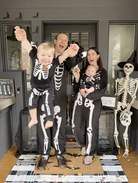 H A L L O W E E N \ Just a bunch of bones🦴💀🦴 The past two years we've added a little skeleton into our fam! I can't believe we have TWO boys!!🤯 We are all in our skellys tonight and enjoying Halloween week!!🖤💀 Def had one for Bentley and totally spaced it!! #mombrain  Swipe right to see more pics from tonight… getting Ford to get in the photo was a bit challenging LOL  There are a few past gems at the end!💀💀💀 This door pic has become a tradition of ours… how long do you think I can get the boys to do it?? Forever, riiiiight?!!😝 Hoping they have a love for Halloween and all the magical things that Fall brings🧙🏻♀️✨  #halloweencostumes #halloween #skeletons  #LTKfamily #LTKSeasonal