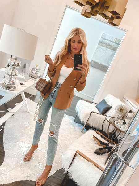 Because you can never go wrong with a simple blazer and a really good pair of jeans!   This blazer is made of knit material so it's crazy soft and I love the lux gold buttons! It comes in 3 colors and looks way more expensive than it really is. It runs tts, I'm wearing an XS.   PS - my bodysuit, jeans, and heels are each under $100!   #LTKshoecrush #LTKunder100 #LTKstyletip