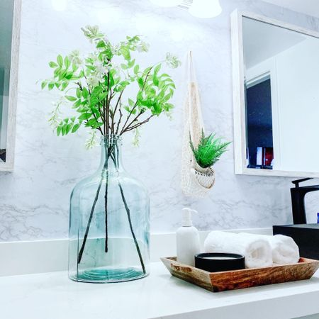 Bathroom decor inspiration. Black faucets and simple glass vase from Target.   #LTKhome