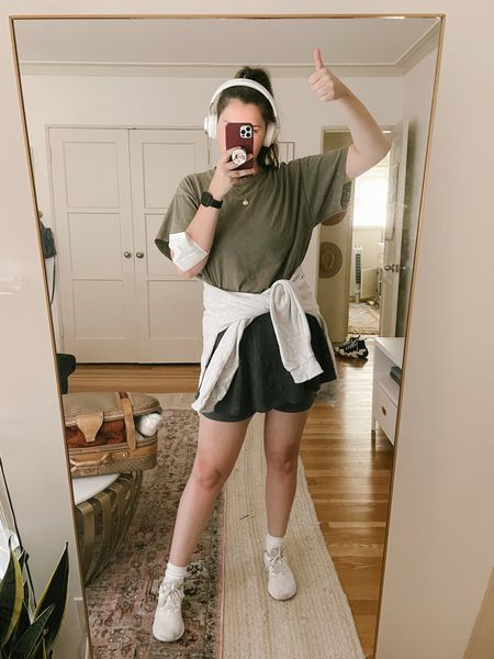 free people fp movement black Ballet All Day Skort, biker shorts, skirt, fitness, workout outfit, ankle socks with smiley face, olive green workout top, sweatshirt, Amazon headphones, gold jewelry, Fitbit, Nike running shoes, casual outfit  #LTKunder100 #LTKunder50 #LTKfit
