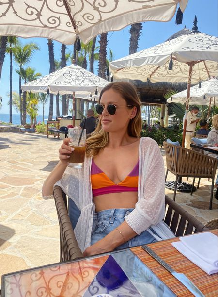 Love this colorful free people bikini I wore on my recent beach vacation! I styled it with a long coverup (on major sale right now!) and the best denim shorts (TTS) for lunch by the pool!  #LTKunder100 #LTKsalealert #LTKswim