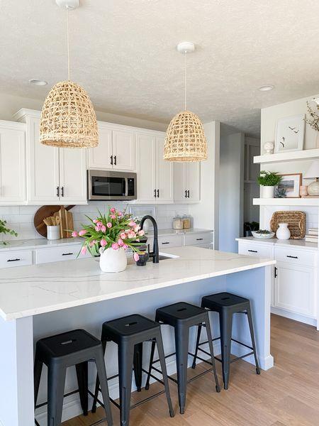 A beautiful kitchen by @stephens.homes.  Kitchen   island   vase   studio McGee   sea grass pendants   bar stools   shelves   lamp   cookbook   flowers     #LTKhome #LTKstyletip #LTKunder50