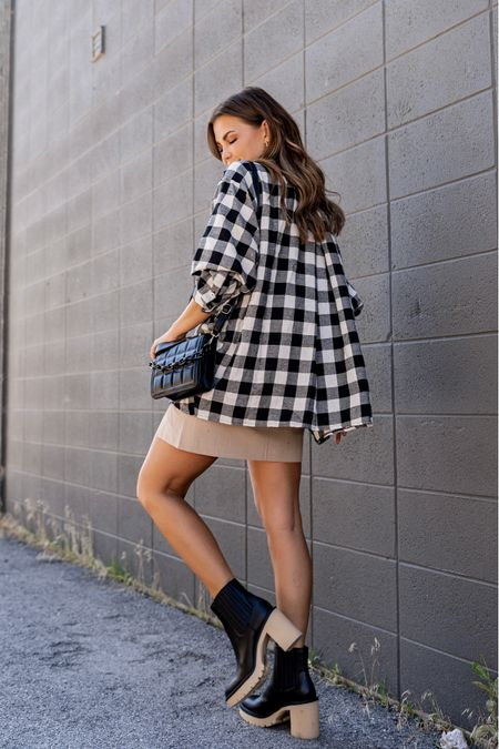 Dolce Vita Caster Boots - waterproof!!!   Fall Outfit from Red Dress Boutique -  Tan Skirt and Black and White Plaid top   Quilted black bag       #LTKstyletip #LTKshoecrush #LTKSeasonal