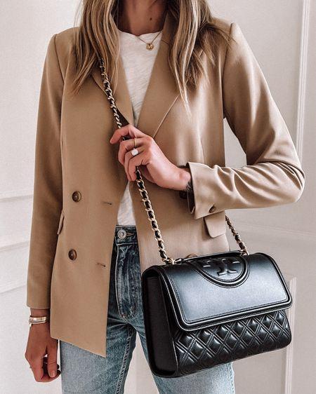A luxury alternative bag under $500! Contemporary designer bags from shopbop! Black bag, Tory Burch http://liketk.it/3kmSM   #liketkit #LTKstyletip #LTKitbag @liketoknow.it