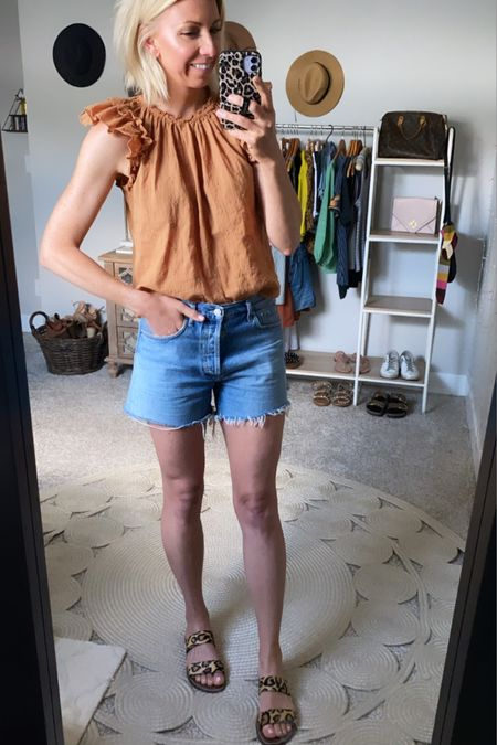#liketkit @liketoknow.it http://liketk.it/3h7b9  My go-to summer outfit combo in the heat… Denim shorts + cotton blouse + printed sandals  #agolde #summeroutfit #LTKunder50 #LTKunder100 #LTKtravel
