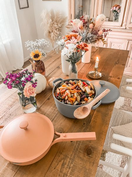 """Here's the first look at the dining room with the new table! (#ad) I accented it with my favorite Always Pan in spice and Perfect Pot in their new color dusty blue! Both of them have a nontoxic coating and can do so many different things!   The pot can be used as a dutch oven, stock pot, sauce pan, roasting rack, steamer, colander, and broiler! I save a lot of kitchen space using the pot for all sorts of things and I actually leave the pot on the stove/on my floating shelves to double as decor!  P.S. you can use my code """"MICHELLE10"""" for 10% off! @ourplace #FromOurPlace"""