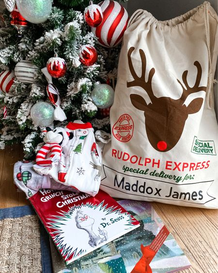 """I love the whole holiday season and I've been so excited to get to celebrate it with Maddox. I've been wanting to start a new tradition for our family that helps get us in the holiday spirit all December long. After searching and some inspo from other moms I came up with a great idea that we have started this year 🎄  Maddox's Nooney made him the most adorable Santa sack which has no become the official Christmas bag! December 1st the Christmas bag that gets """"delivered""""(Rudolph delivers ours 😉)with some fun things for our family to enjoy throughout the holiday season. This year I included some holiday pajamas for the fam (to get more wear out of them than just on Christmas) and holiday onesies for Maddox. For activities I added a few of Matt and my favorite holiday books growing up and a few holiday toys. ✨  Each year we can evolve the contents to fit Maddox's age and eventually get to crafts, baking, and other fun holiday activities. I think this is such a cute way to extend the holiday magic and make activities or things you were going to buy anyway even more special since they are delivered in the Christmas bag! 🎁   The last part of the tradition as part of our December holiday spirit we will do something as a family to give back. This year we are going through some unused dog supplies and donating them to a local rescue ❤️  I want to hear what holiday traditions you have started with your little ones! How have they changed over the years! 🎅🏼  . . . . . . . .  http://liketk.it/33O8S @liketoknow.it #liketkit #StayHomeWithLTK #LTKbaby #LTKkids"""