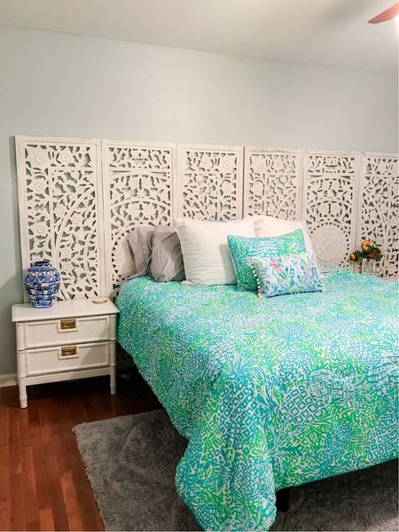 Headboard inspo: we used two room dividers for our king headboard! Unique + trendy. Palm Beach inspired Lilly Pulitzer colorful bedroom.   #LTKhome #LTKstyletip #StayHomeWithLTK